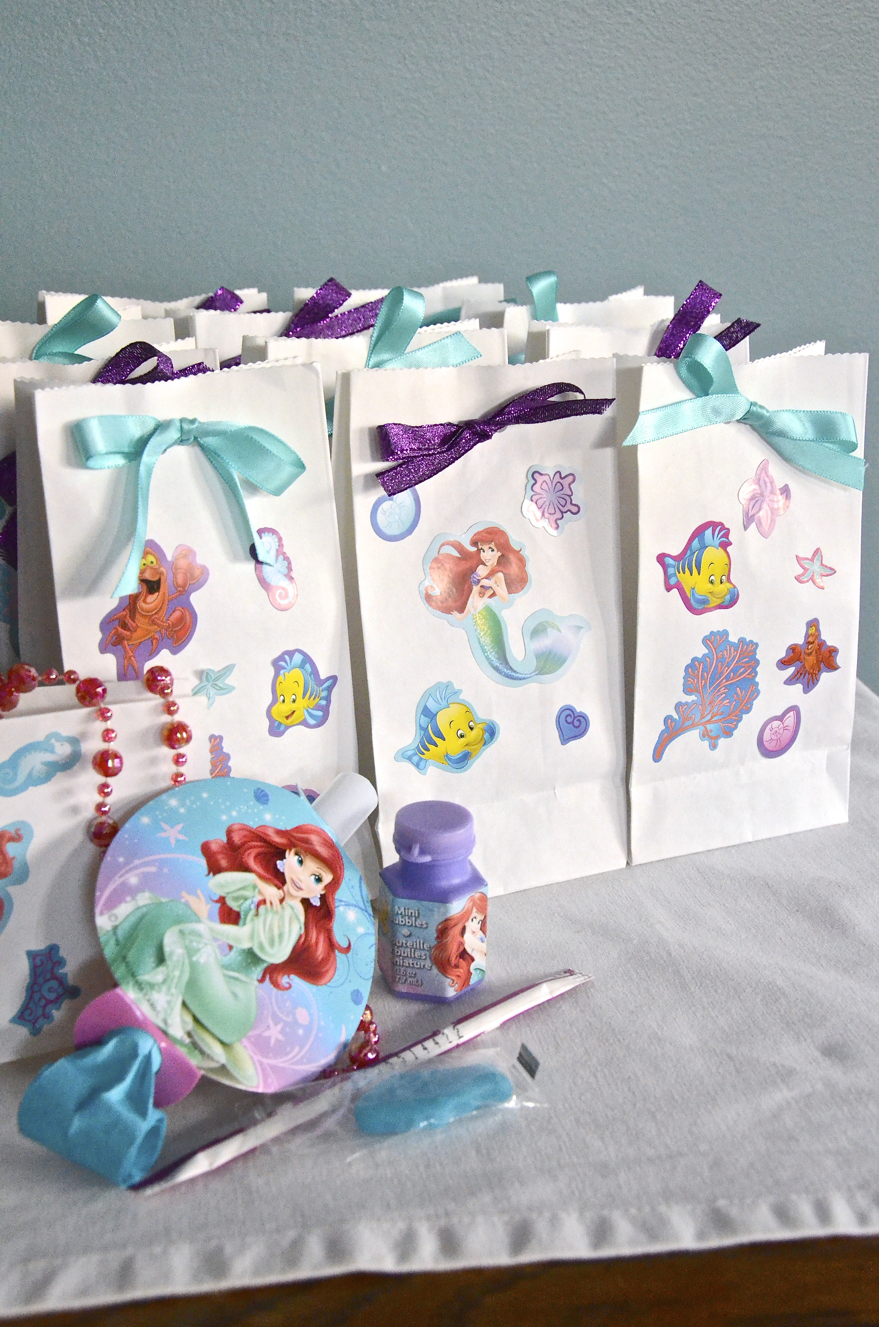 DSC_0751 little mermaid party favor bags on happy birthday beach cake images
